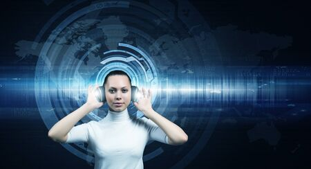 virtual assistant: Young woman wearing headphones on digital blue background