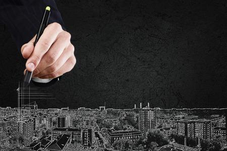 닫기 손의 최대 도시의 도시 건물 그리기