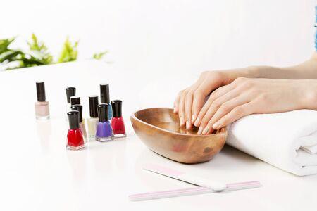 woman in bath: Woman in nail salon with hails in bath