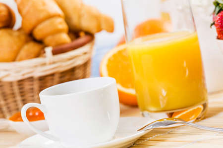 coffees: Breakfast with assortment of pastries, coffees and fresh strawberries