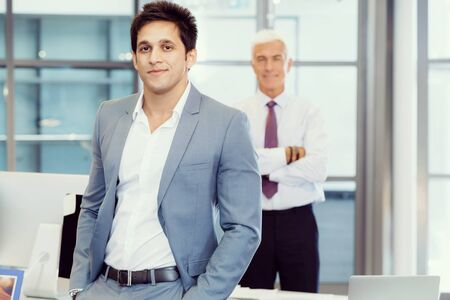 collegue: Portrait of businessman with collegue on background Stock Photo