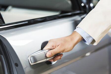 grasp: Close up of human hand opening door of car Stock Photo