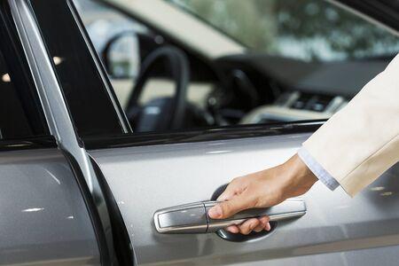 opening door: Close up of human hand opening door of car Stock Photo