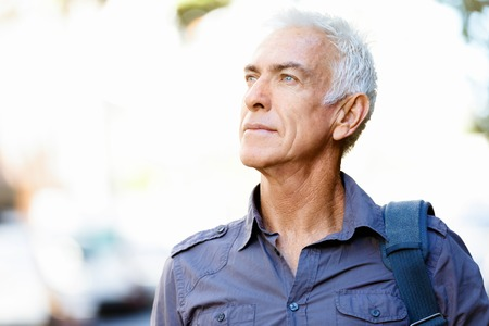 Handsome man with grey hair outdoors