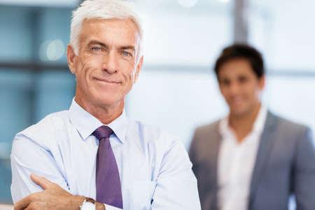 collegue: Portrait of businessman with collegue