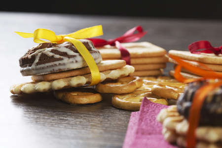 Stack of delicious cookies on table tied with ribbon Stock Photo