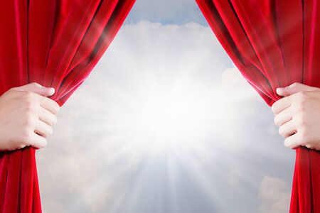 opulent: Close up of hand opening red curtain. Place for text Stock Photo