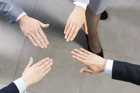 altogether: Close up of business peoples hands on top of each other