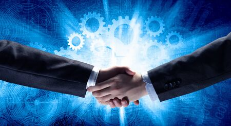 agreeing: Close up of business handshake on digital background