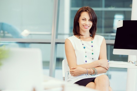 business confidence: Modern business woman in the office