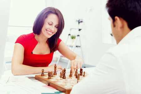 firmness: Businesswoman playing chess in office