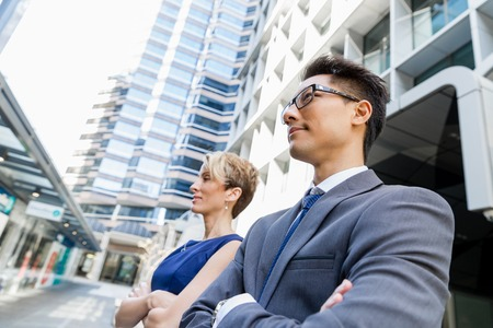next to each other: Businessteam members standing next to each other in business district