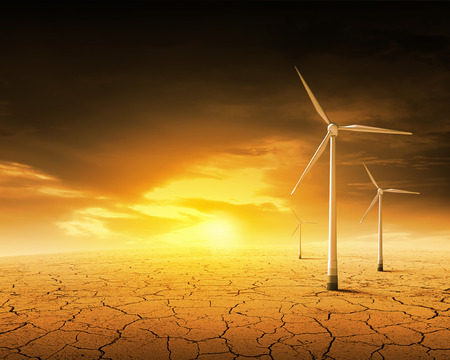 plato: Concept of alternative electricity power with windmills on sunset background