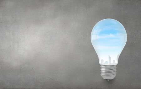 savings problems: Ecology concept with light bulb and city inside