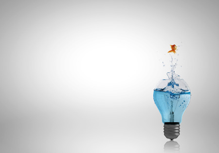 Conceptual image with light bulb filled with clear water