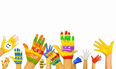 Image of human hands in colorful paint with smiles Stockfoto