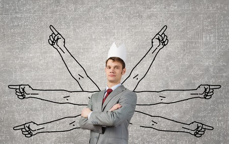 hands behind back: Young man with many drawn hands behind back Stock Photo