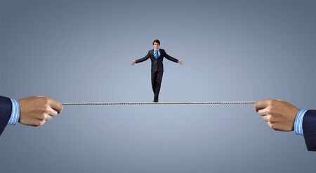 brave: Young brave ricky businessman balancing on rope