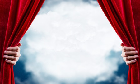open concept: Close up of hand opening red curtain. Place for text Stock Photo