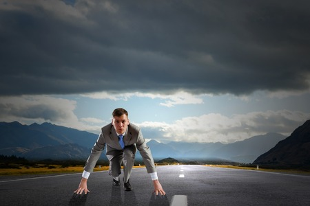 start position: Young determined businessman standing in start position