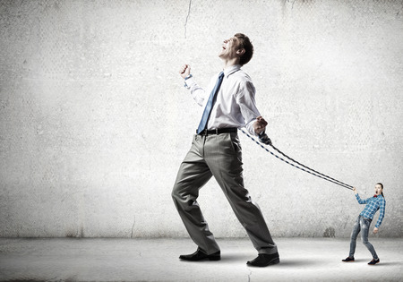 occur: Businessman struggling with problems that occur on the way Stock Photo