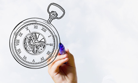 Close up of hand drawing pocket watch with marker