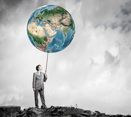 lead rope: Businessman controlling Earth planet with lead. Elements of this image are furnished by NASA
