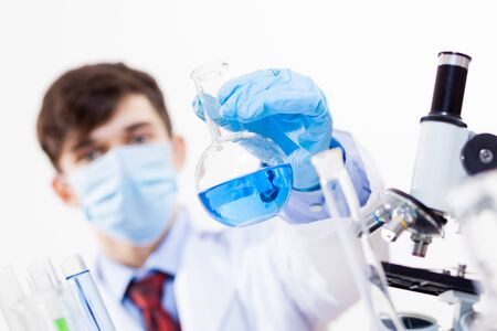 Young scientist making chemical tests in laboratory Stock Photo