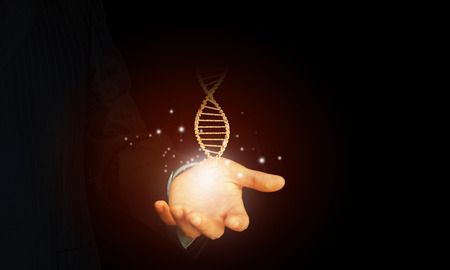 dna helix: Close up of man holding DNA molecule in palm