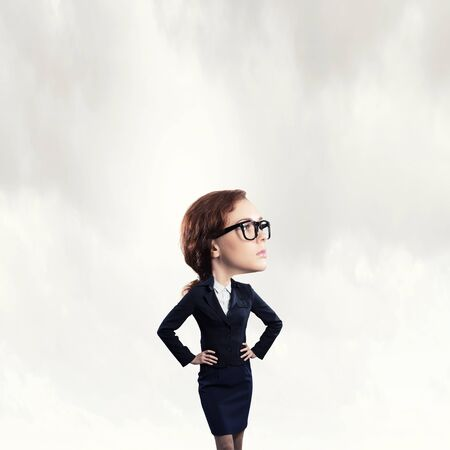 funny face: Funny young businesswoman with big head wearing glasses Stock Photo