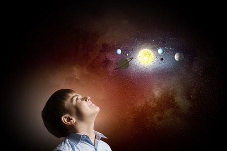space age: Cute boy of school age exploring space system Stock Photo