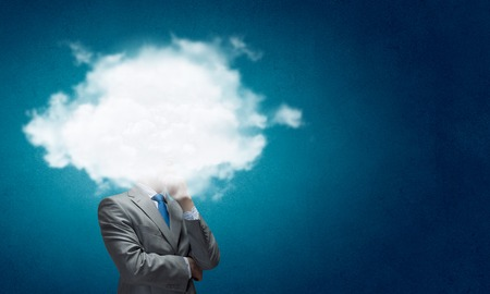 thinking cloud: Businesswoman standing with cloud instead of head