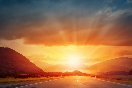 sunset sunrise: Picturesque landscape scene and sunrise above road