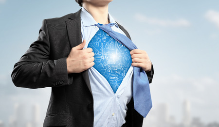 powerful creativity: Businessman opening his shirt on chest acting like super hero