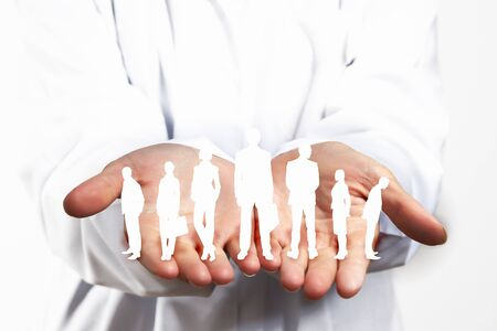 linked hands: Close up of human hands with row of people figures