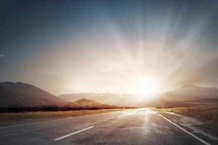 serene landscape: Picturesque landscape scene and sunrise above road