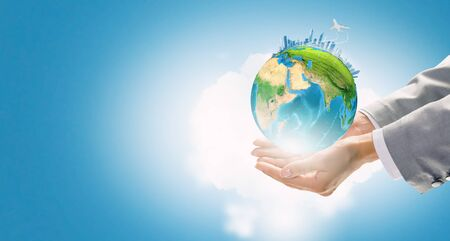 Close up of female hand holding our Earth planet. Elements of this image are furnished by NASA
