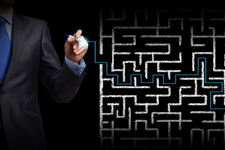 start business: Close up of businessman drawing way out of labyrinth Stock Photo