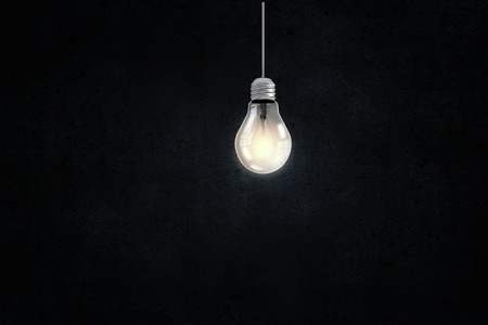 Illuminating hanging light bulb on dark background Stock fotó - 42328498