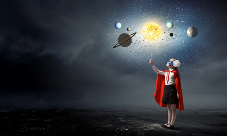 school girl: Cute girl of school age exploring space system Stock Photo