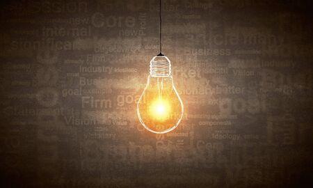 illuminating: Illuminating hanging light bulb on dark background