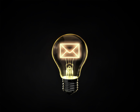 addressee: Light bulb with mail sign on dark background