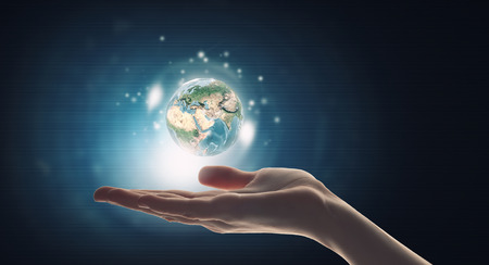 globe people: Human hand holding digital icon of planet earth.