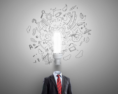 power of savings: Idea concept with businessman and light bulb instead of his head