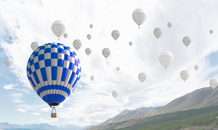 Businessman flying in search of ideas gripping the balloon Stock Photo