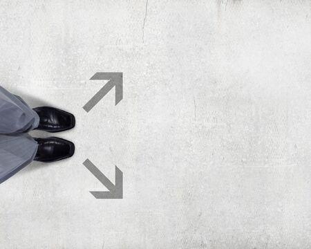 choose person: Top view of businessman legs choosing his way