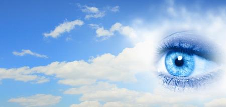 mysticism: Female clear eye on blue sky background Stock Photo