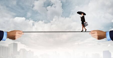 brave: Young brave ricky businesswoman balancing on rope