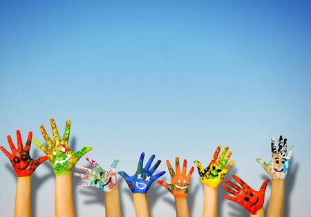 colorful paint: Image of human hands in colorful paint with smiles Stock Photo