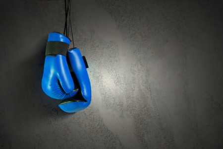boxing equipment: Boxing gloves hanging on nail on wall Stock Photo